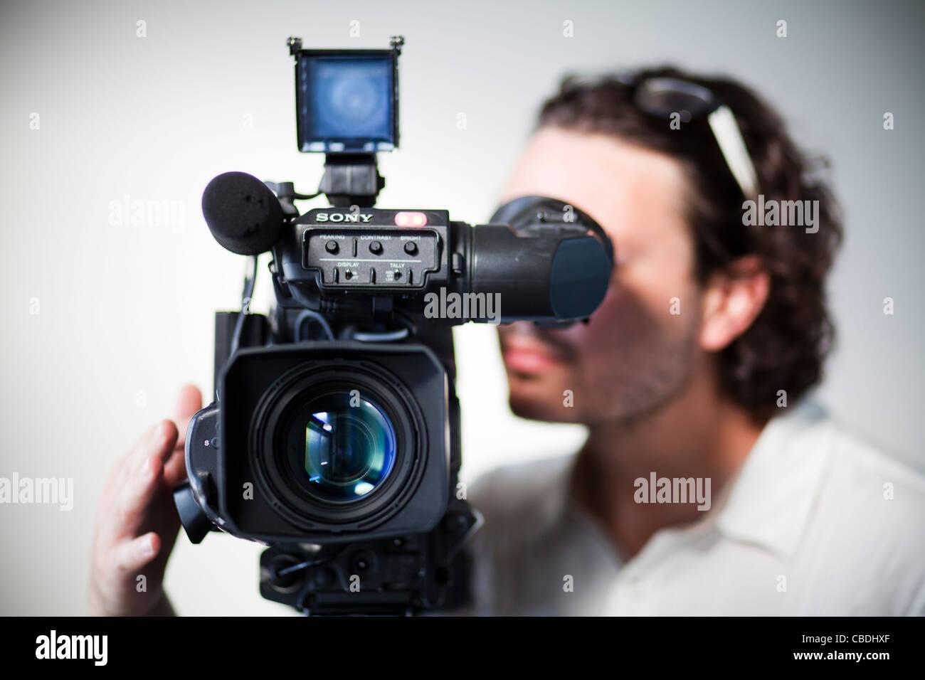 Cameraman with camera  TV, news, journalism, video, recoring