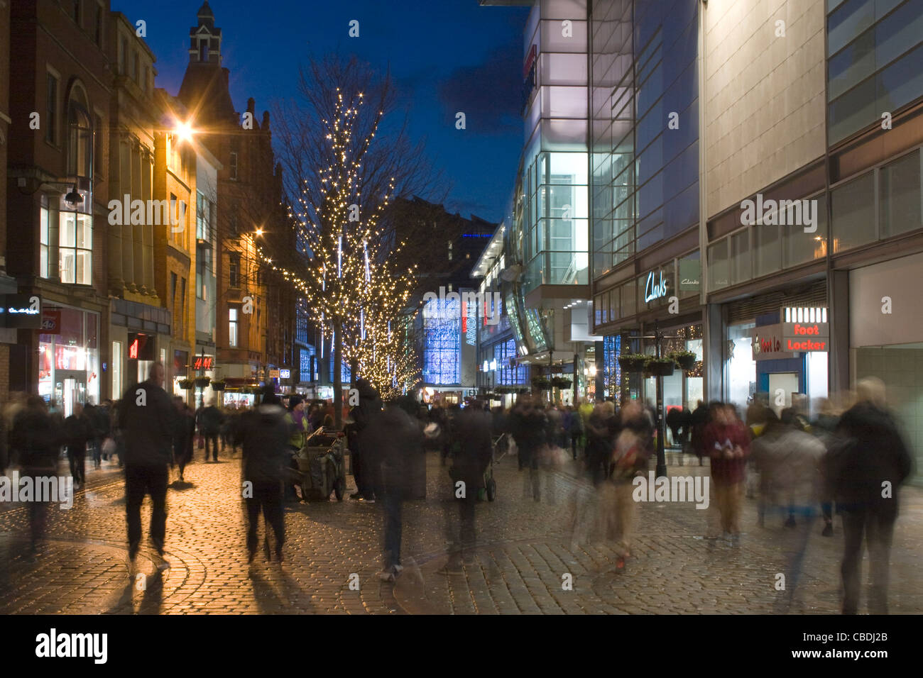 Christmas Shoppers Shopping buying presents  near The Arndale Centre on Market Street Manchester City Centre UK - Stock Image