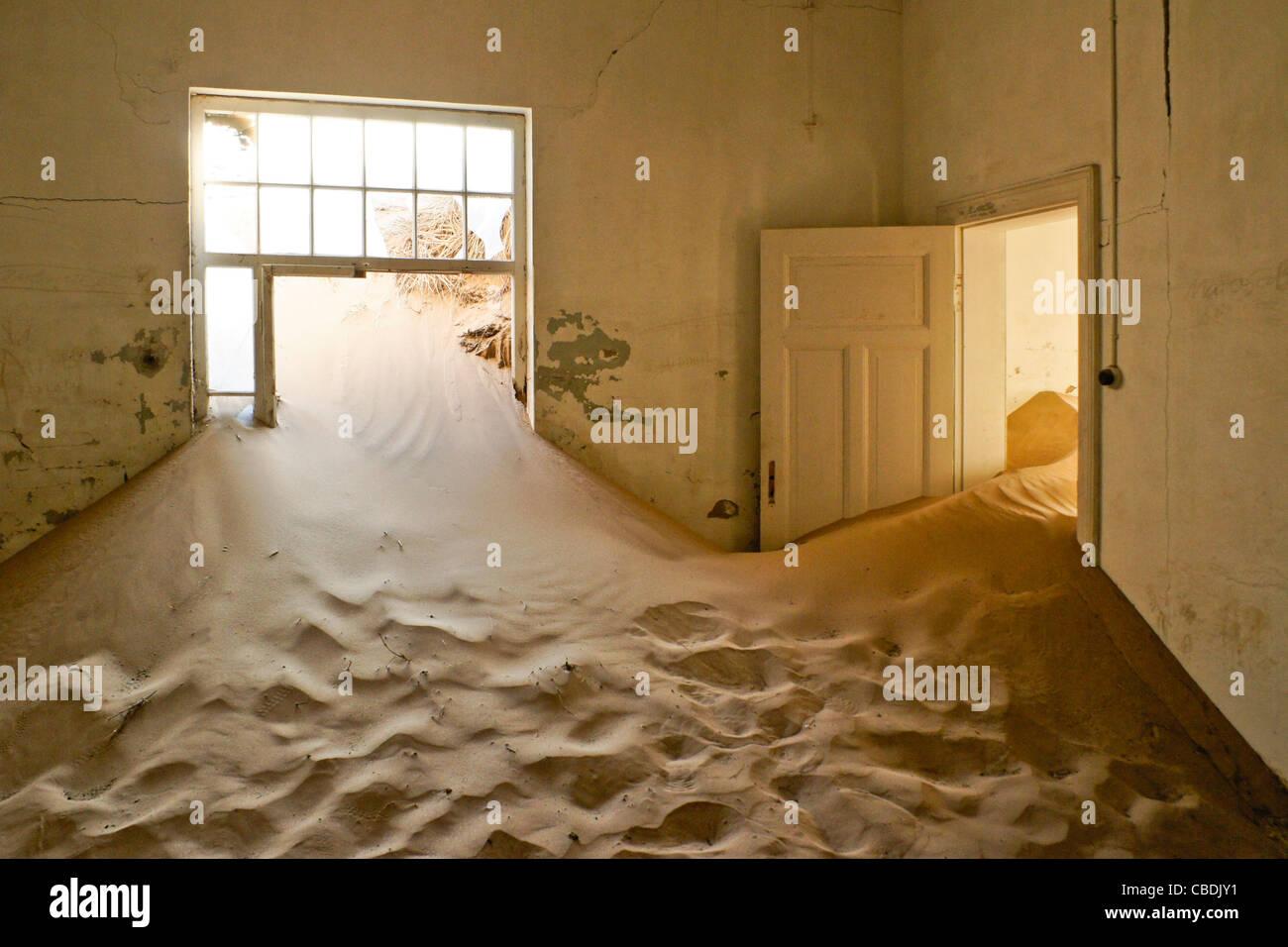 Room in building at abandoned diamond mining town of Kolmanskop, Namibia Stock Photo