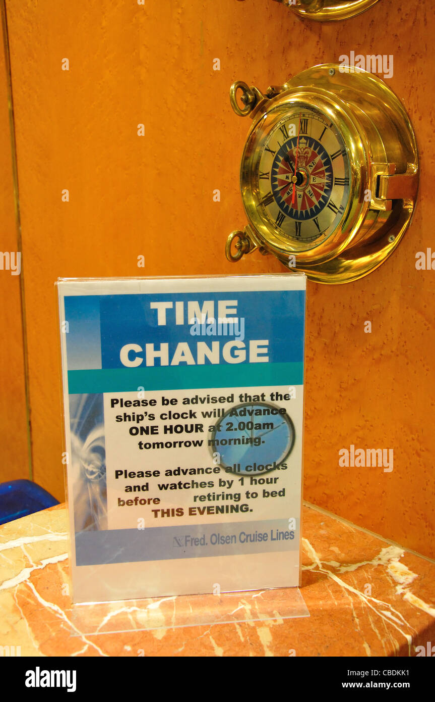 Time change notice at reception, Fred Olsen M.S.Balmoral cruise ship in North Sea, Northern Europe Stock Photo