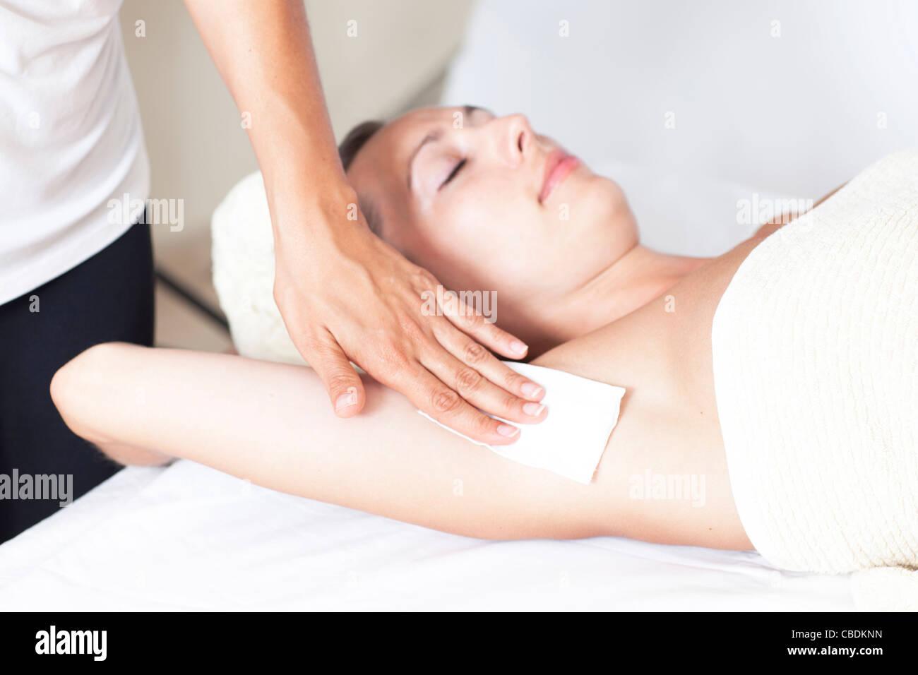 Female armpit depilation in a beauty salon - Stock Image