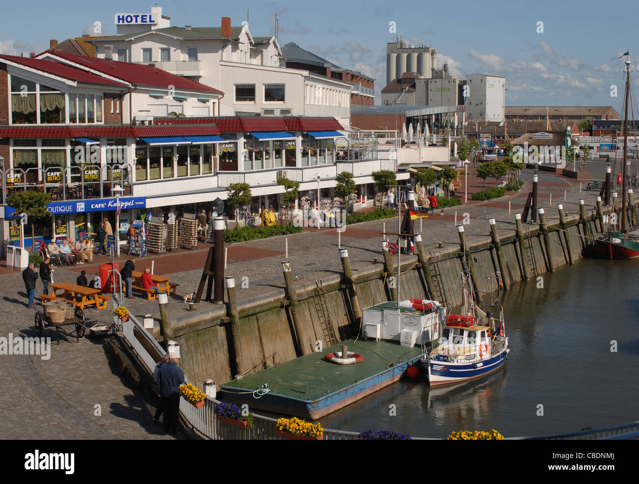 Old port with restaurants and ships along the quay  in Büsum, a seaside resort and holiday destination on the North Stock Photo