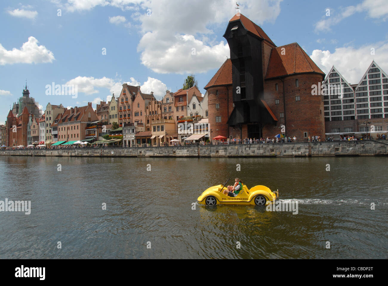 View from Oliwianka towards Stare Miasto, the old town of Gdansk, Danzig, with car-shaped fun boat on the Motlawa - Stock Image