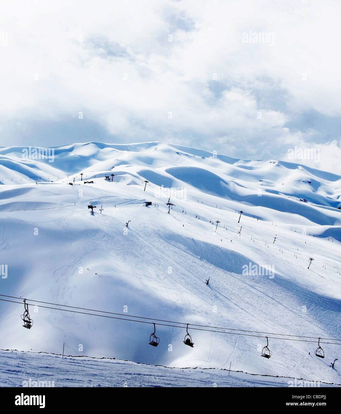 Winter mountain ski resort landscape with snow and chairlift - Stock Image