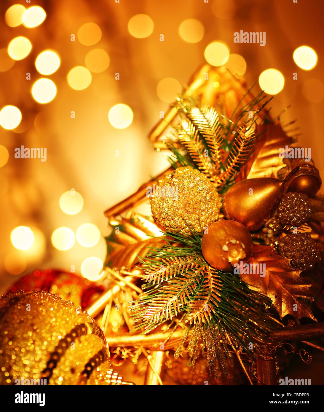 Christmas decoration, holiday background with golden lights - Stock Image