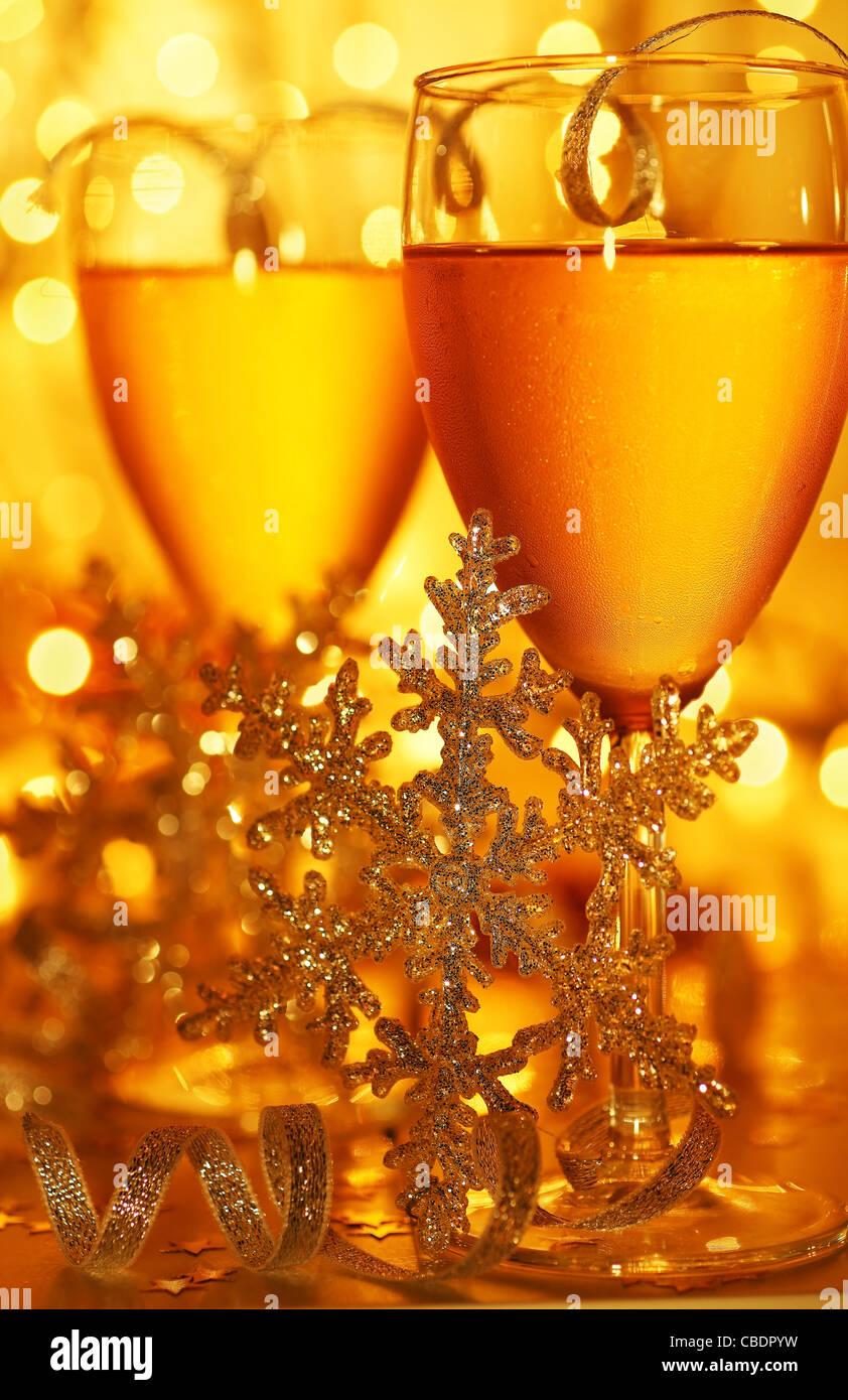 Romantic holiday drink, celebration of Christmas or new year eve, party with Champagne and festive gold ornament Stock Photo