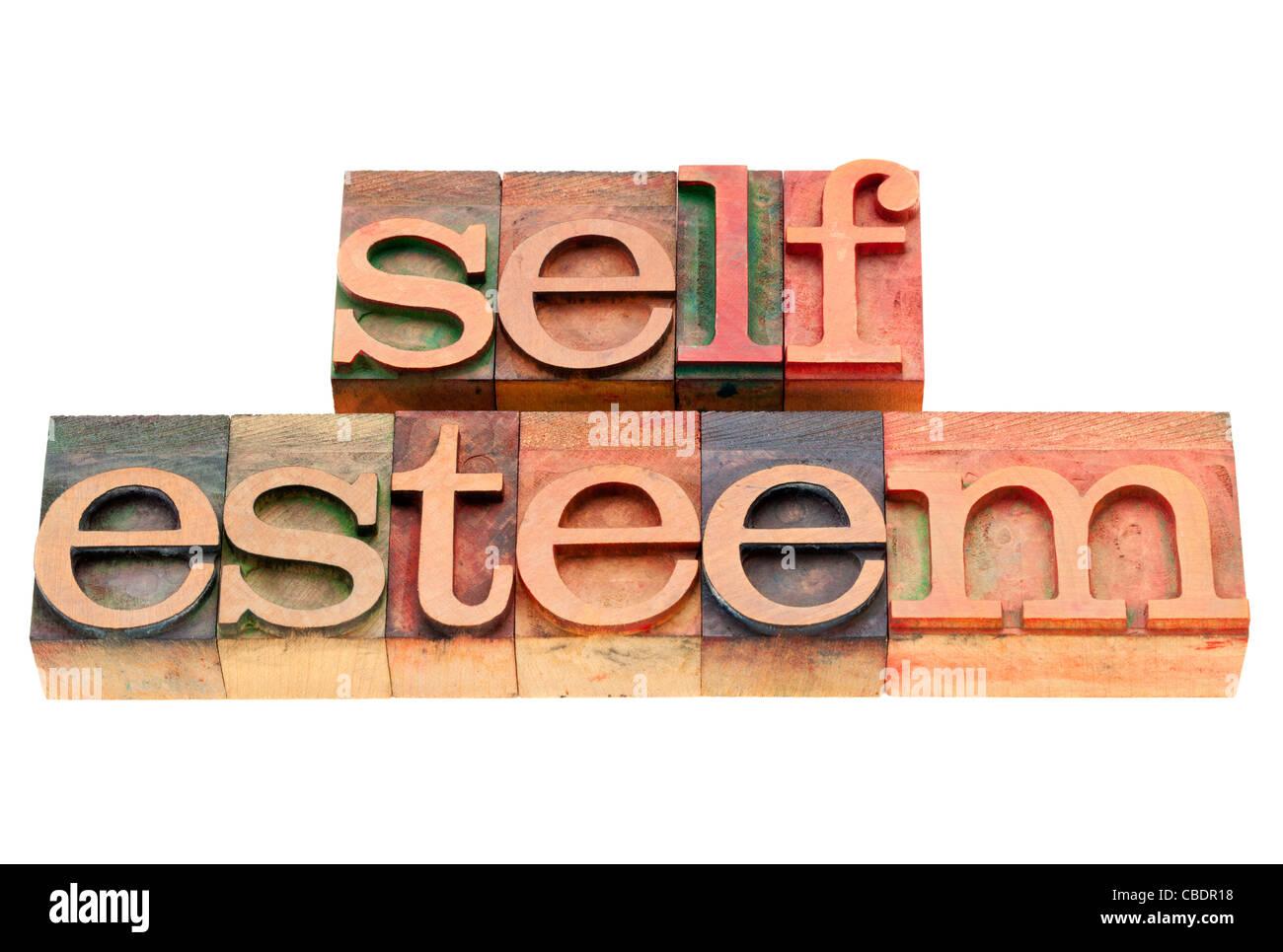 self esteem - isolated text in vintage wood letterpress printing blocks - Stock Image