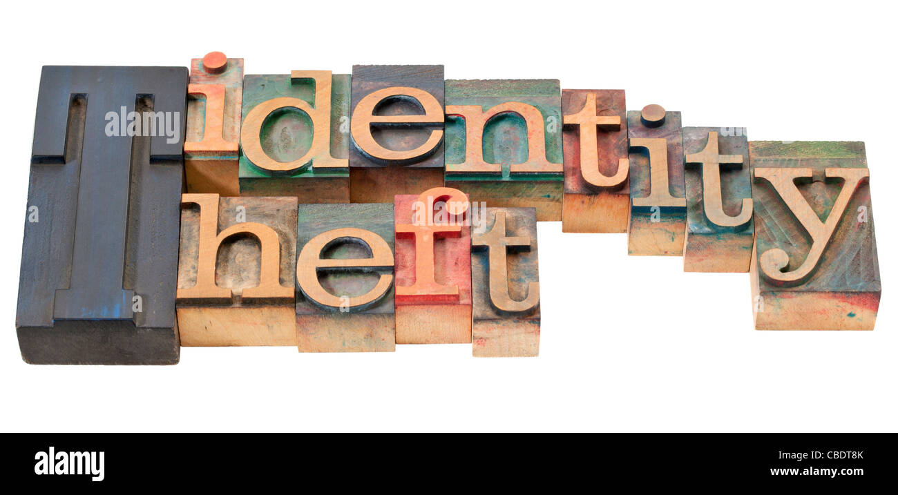 identity theft - isolated phrase in vintage wood letterpress printing blocks - Stock Image