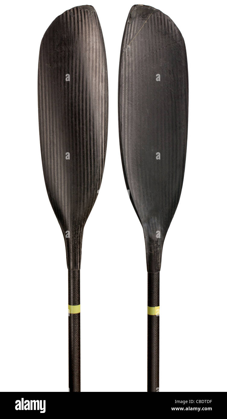 narrow blades of carbon fiber wing kayak paddle, warn out and scratched in river marathon racing, isolated on white - Stock Image