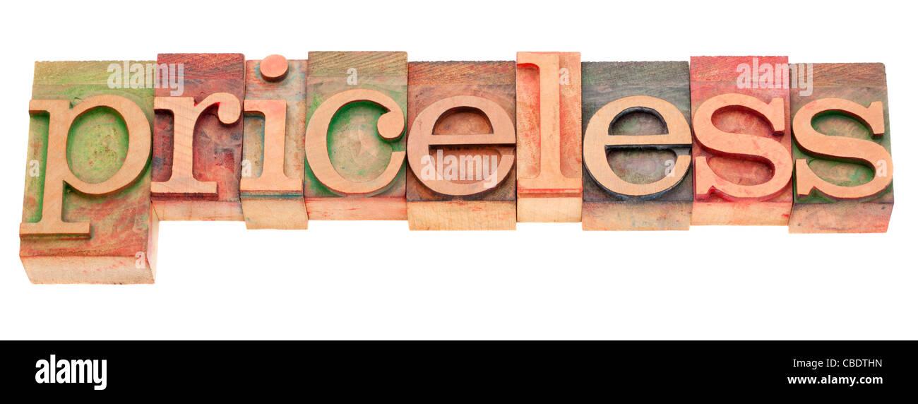 priceless word in vintage wood letterpress type - Stock Image