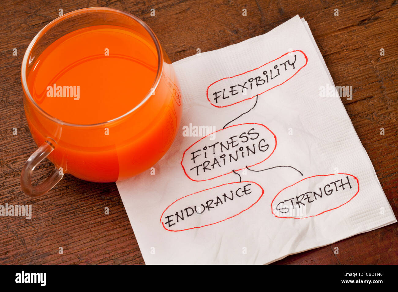 health concept - fitness training - napkin doodle with a glass cup of carrot juice - Stock Image