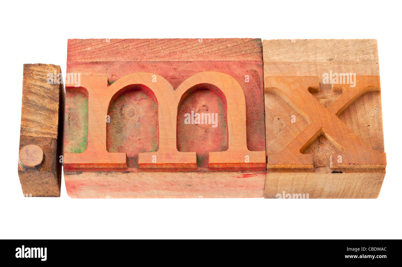 dot mx - internet domain for Mexico in vintage wooden letterpress printing blocks, stained by color inks, isolated - Stock Image
