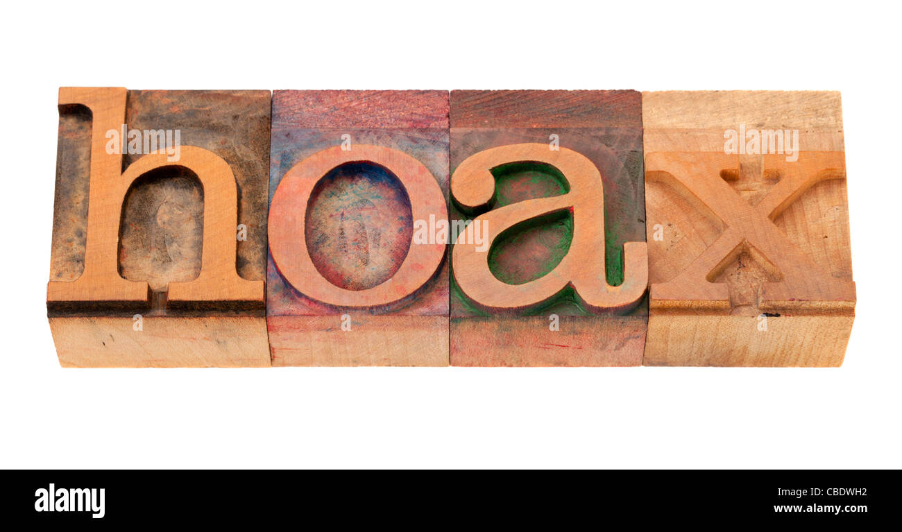 hoax - word in vintage wooden letterpress printing block, stained by color inks, isolated o n white - Stock Image