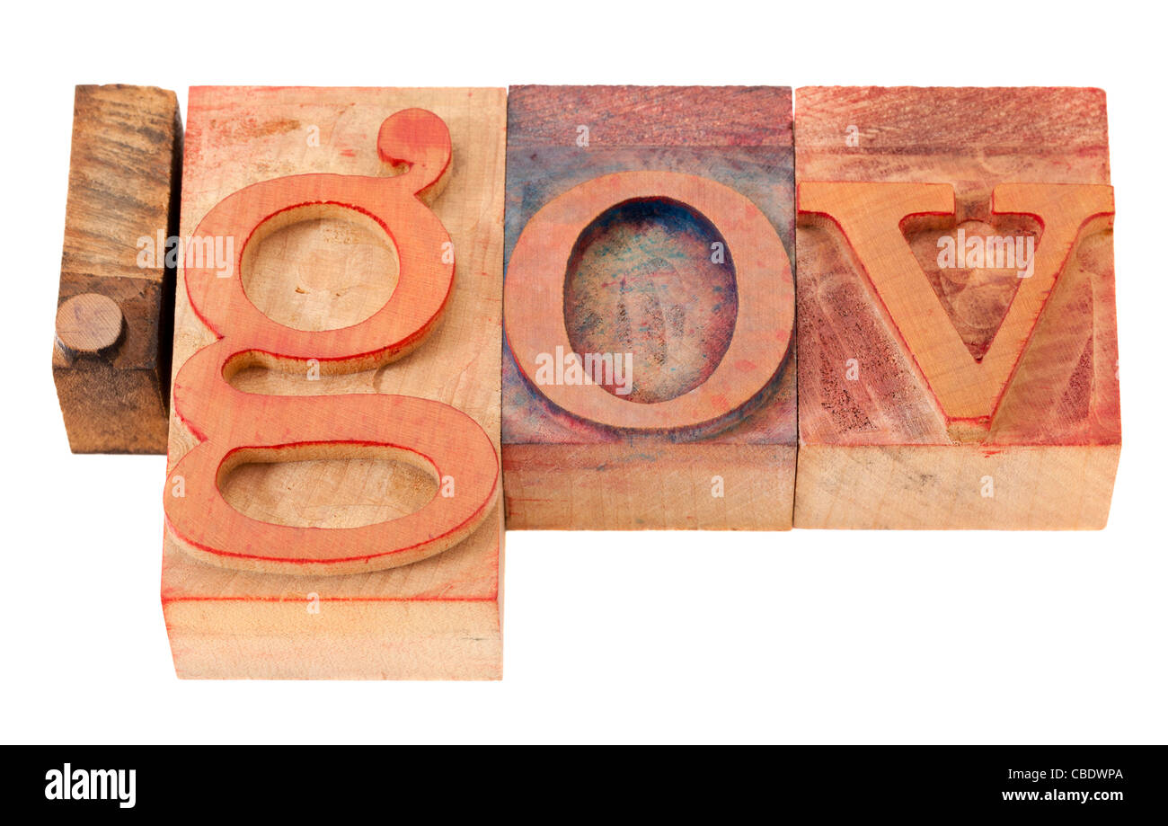 dot gov - internet domain for government in vintage wooden letterpress printing blocks, stained by color inks, isolated - Stock Image