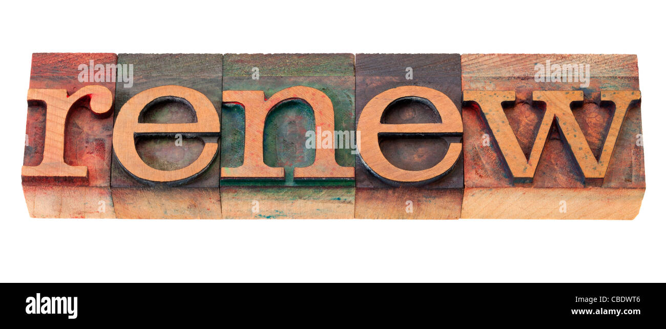 renew word in vintage wooden letterpress printing blocks, stained by color inks, isolated on white - Stock Image