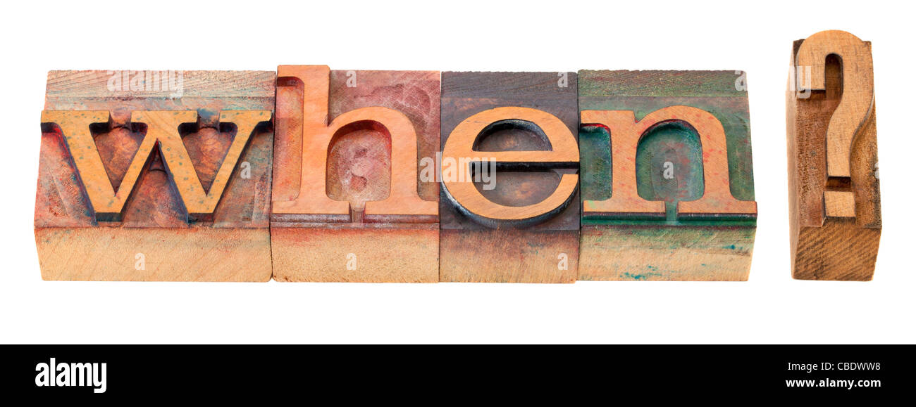 when question in vintage wood letterpress printing blocks, stained by color inks - Stock Image