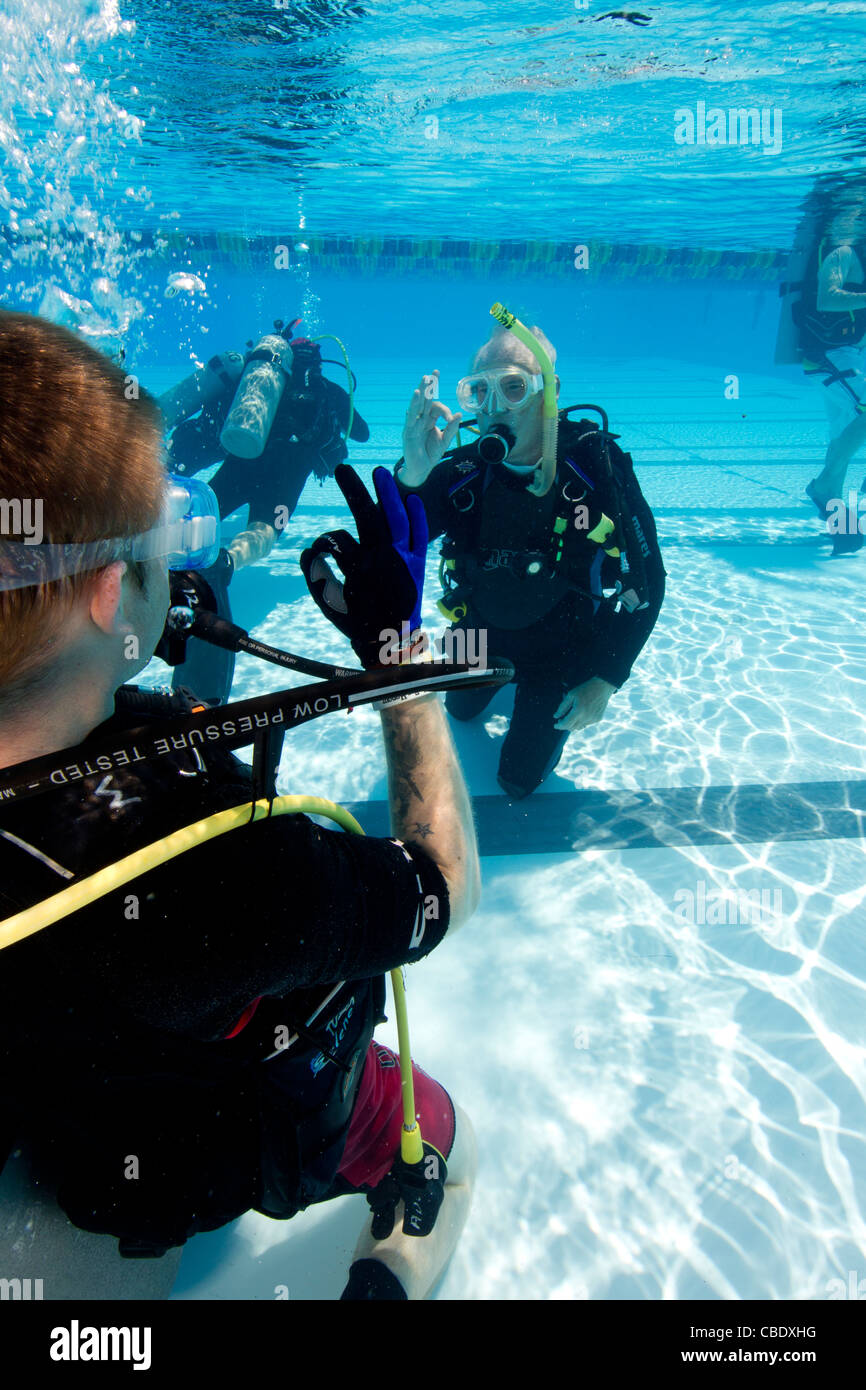 Scuba diving  training as a form of in-water therapy and rehabilitation for wounded military personnel. - Stock Image