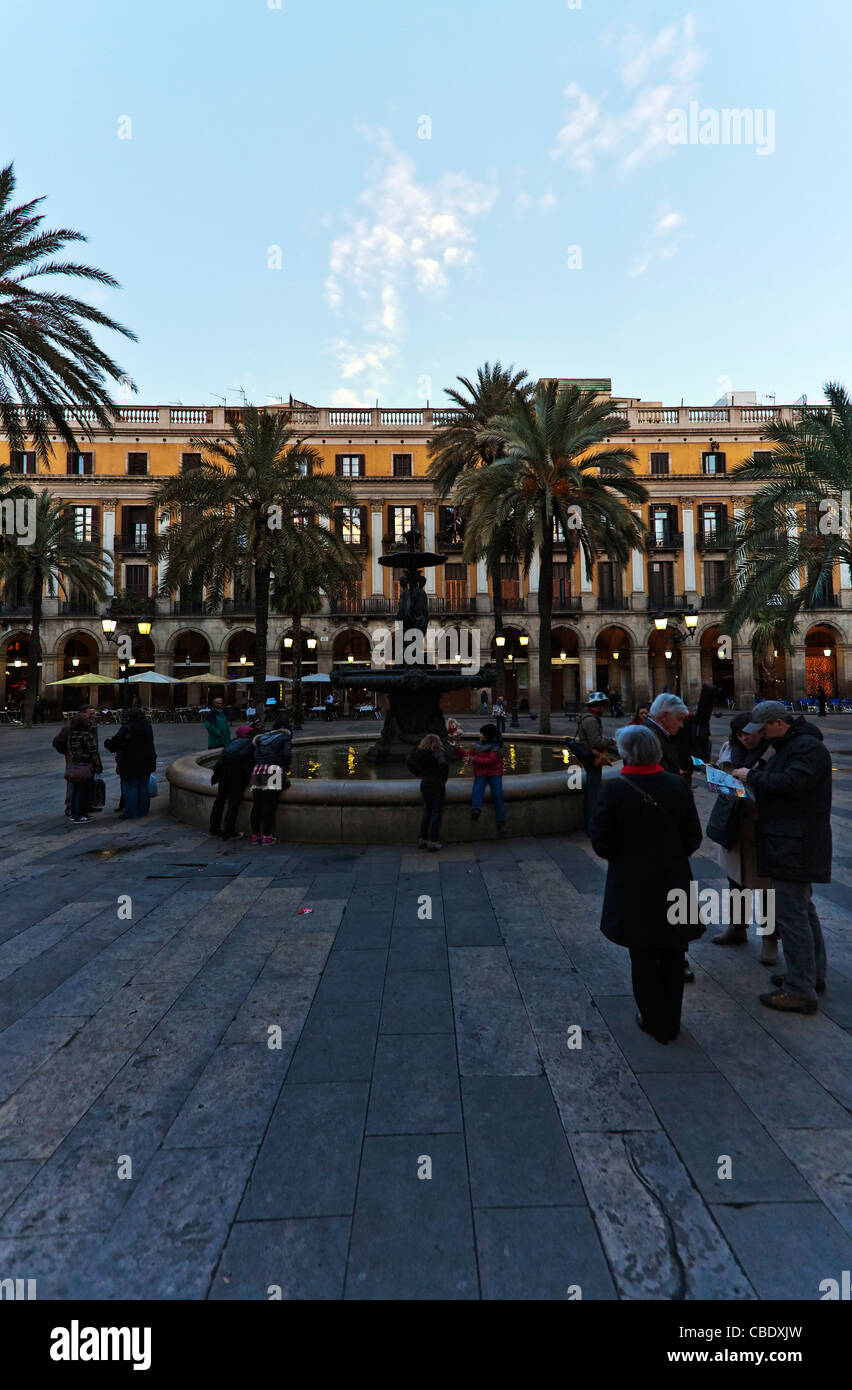 Fuontains and The palm trees and traditionally designed buildings of Placa Reial, in Barcelona, Spain - Stock Image
