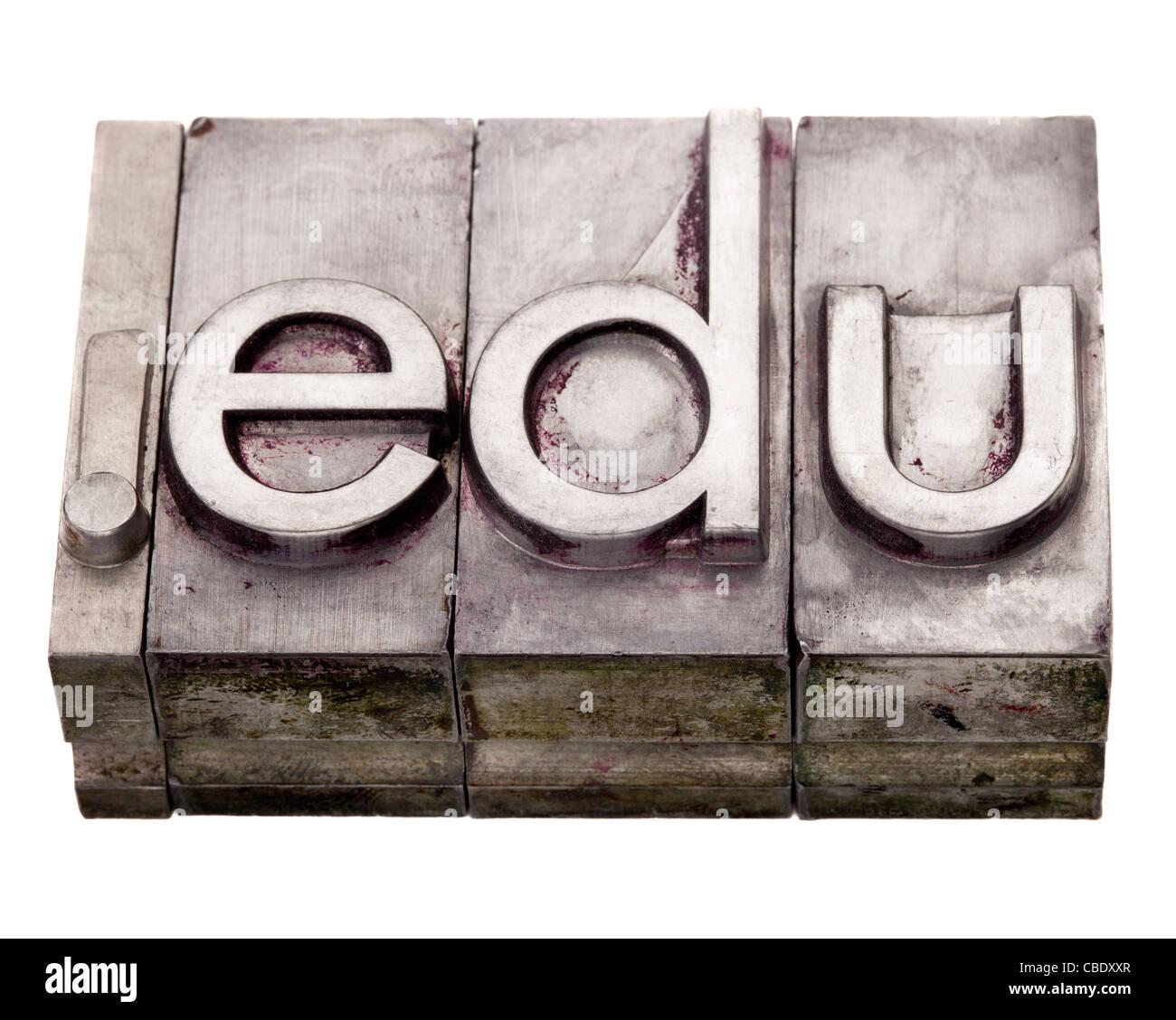 dot com internet educational domain extension in vintage grunge metal letterpress printing blocks - Stock Image