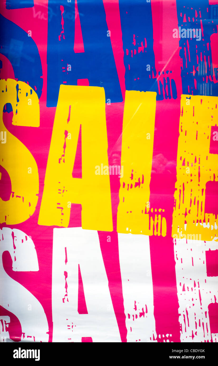 Sale signs in a high street shop window - Stock Image