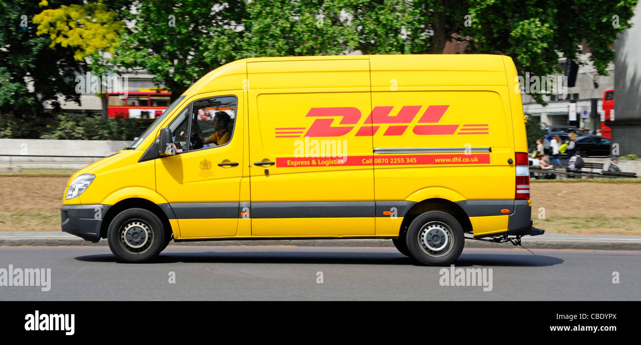 049859e3593c1a DHL express parcel delivery van and driver in yellow van a division of the  German logistics company Deutsche Post DHL West End of London England UK