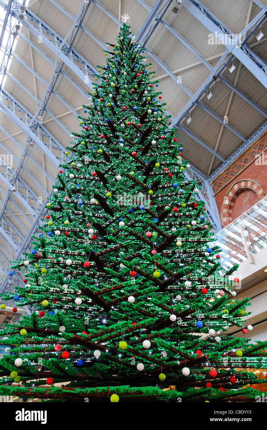 St Pancras International interior of train station with close up of indoor Christmas tree formed from Lego bricks - Stock Image