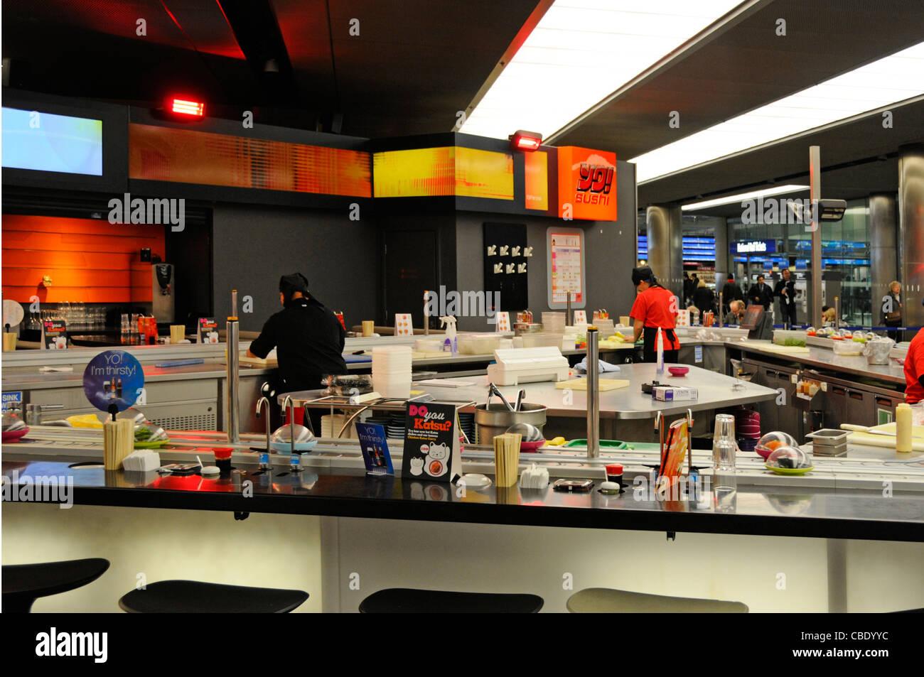 YO! Sushi conveyor belt yo sushi food restaurant at St Pancras train station London England UK - Stock Image