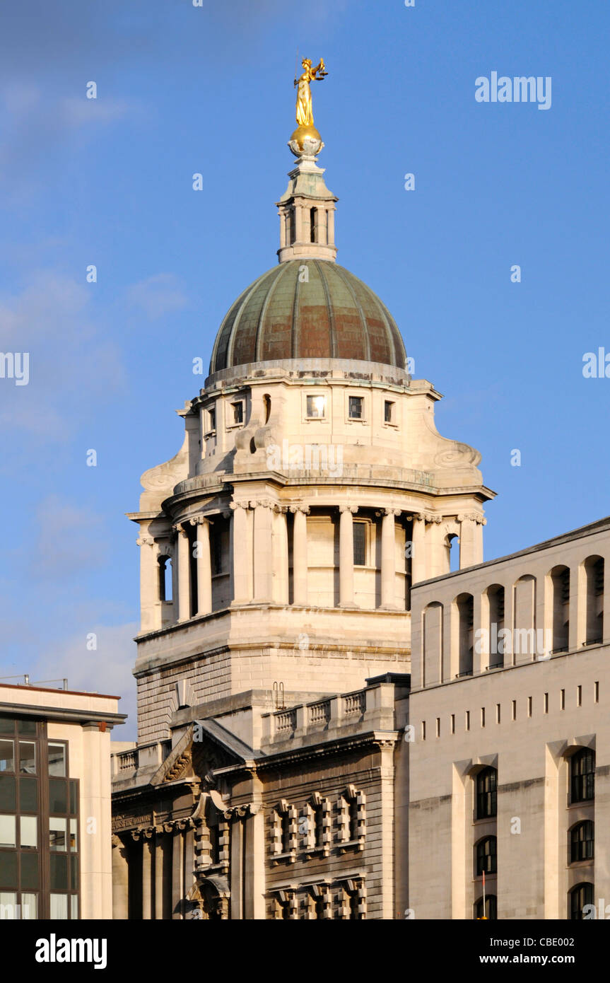 Bronze statue sculpture Lady Justice or Scales of Justice above copper clad roof at Old Bailey courthouse Central - Stock Image