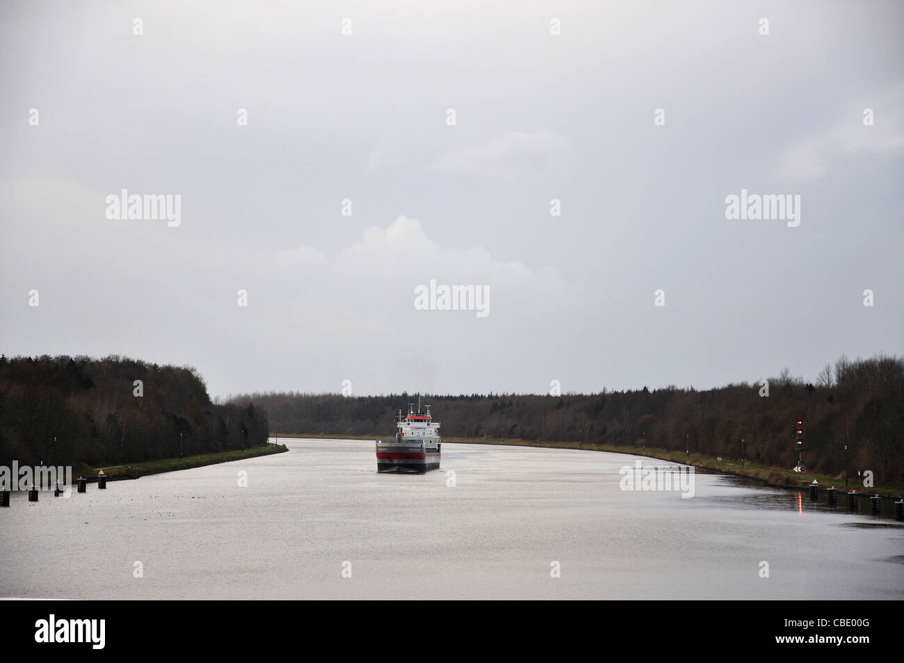 Ship passing through Kiel Canal, Schleswig-Holstein, Federal Republic of Germany - Stock Image