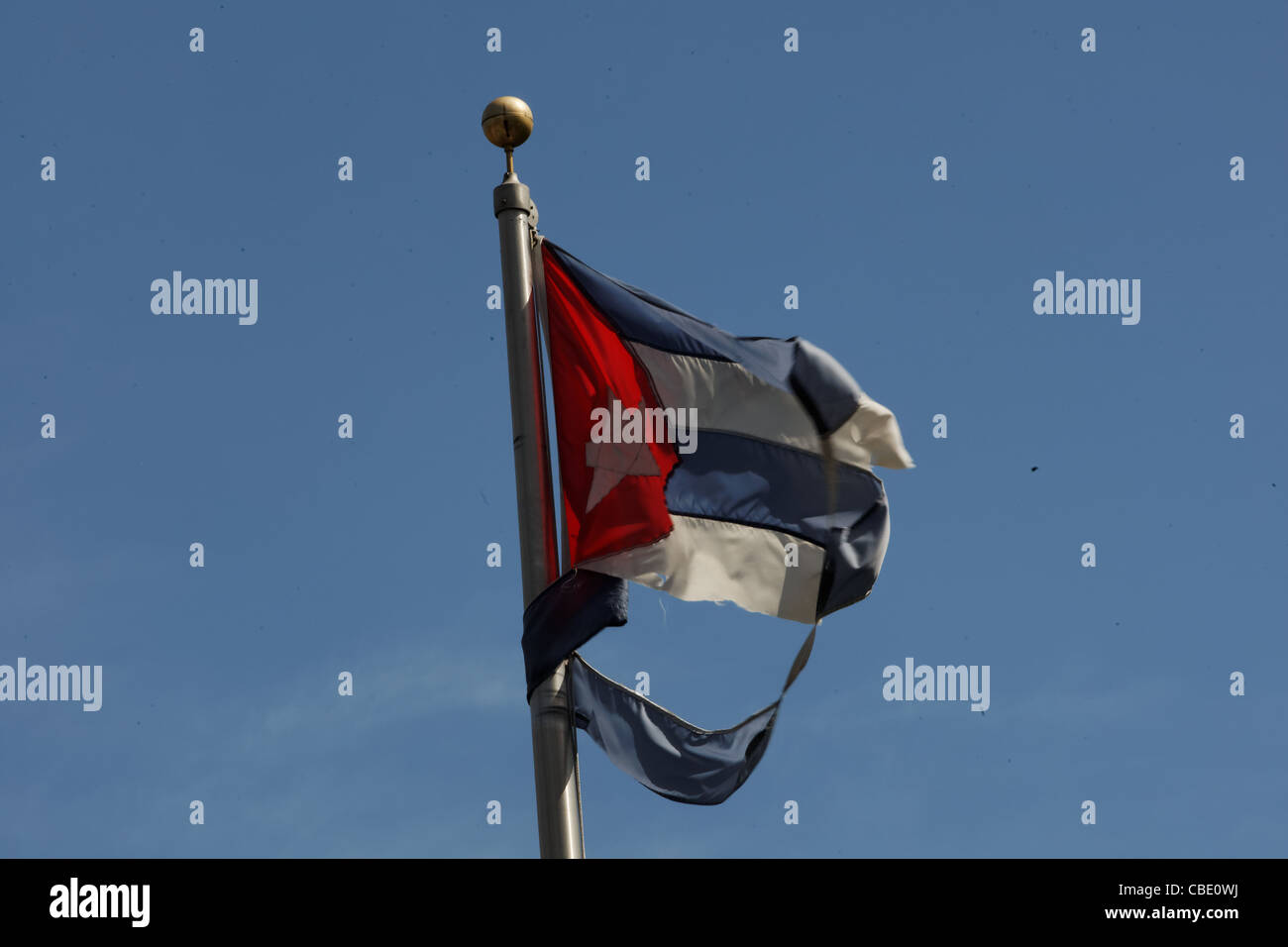 US and Cuban flags fly at the Bay of Pigs memorial in Miami, Florida's little Havana neighborhood commemorates - Stock Image