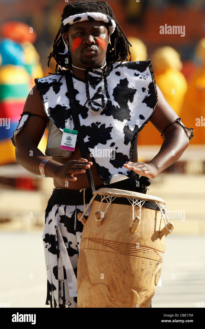 A drummer performs at the opening ceremony of the FIFA World Cup soccer tournament at Soccer City Stadium on June - Stock Image