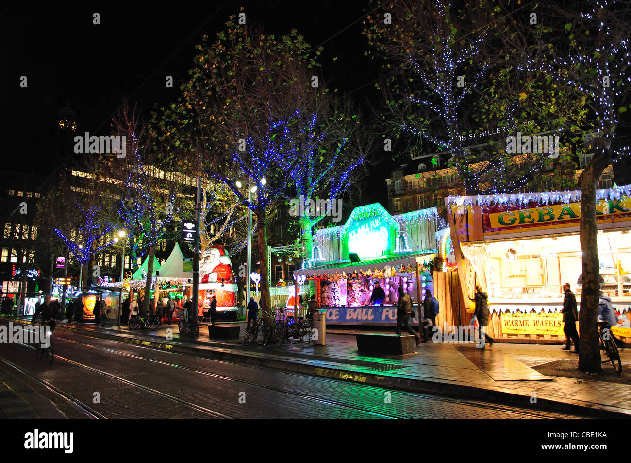 Christmas market at night, Rembrandtplein, Amsterdam, Noord-Holland, Kingdom of the Netherlands - Stock Image
