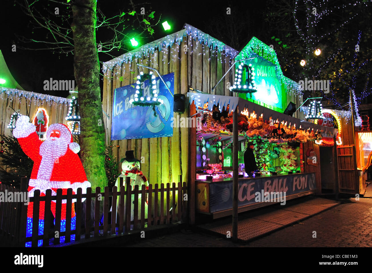 Crystal LED Father Christmas and stall at Christmas market, Rembrandtplein, Amsterdam, Noord-Holland, Kingdom of - Stock Image