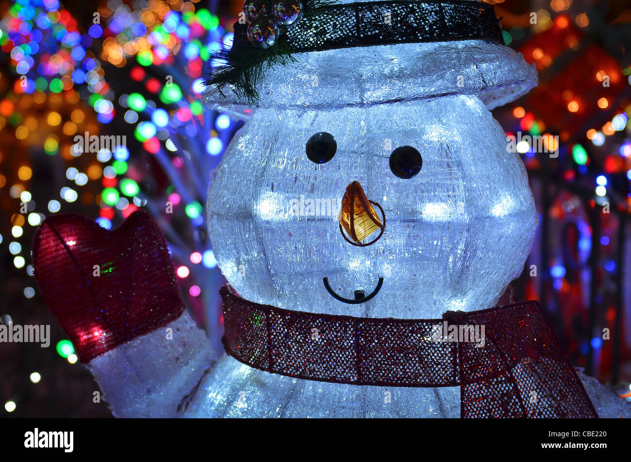 Christmas concept with outdoor snowman lights at night stock photo christmas concept with outdoor snowman lights at night mozeypictures Choice Image