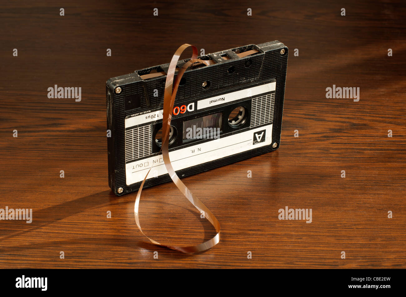 Audio tape cassette with subtracted out tape. Old broken cassette - Stock Image