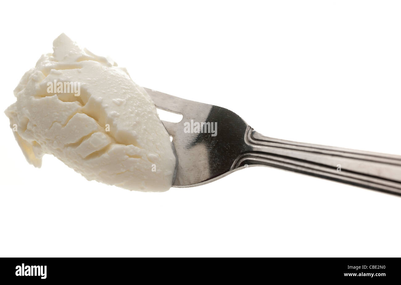 Fork full of Quark low fat soft cheese - Stock Image