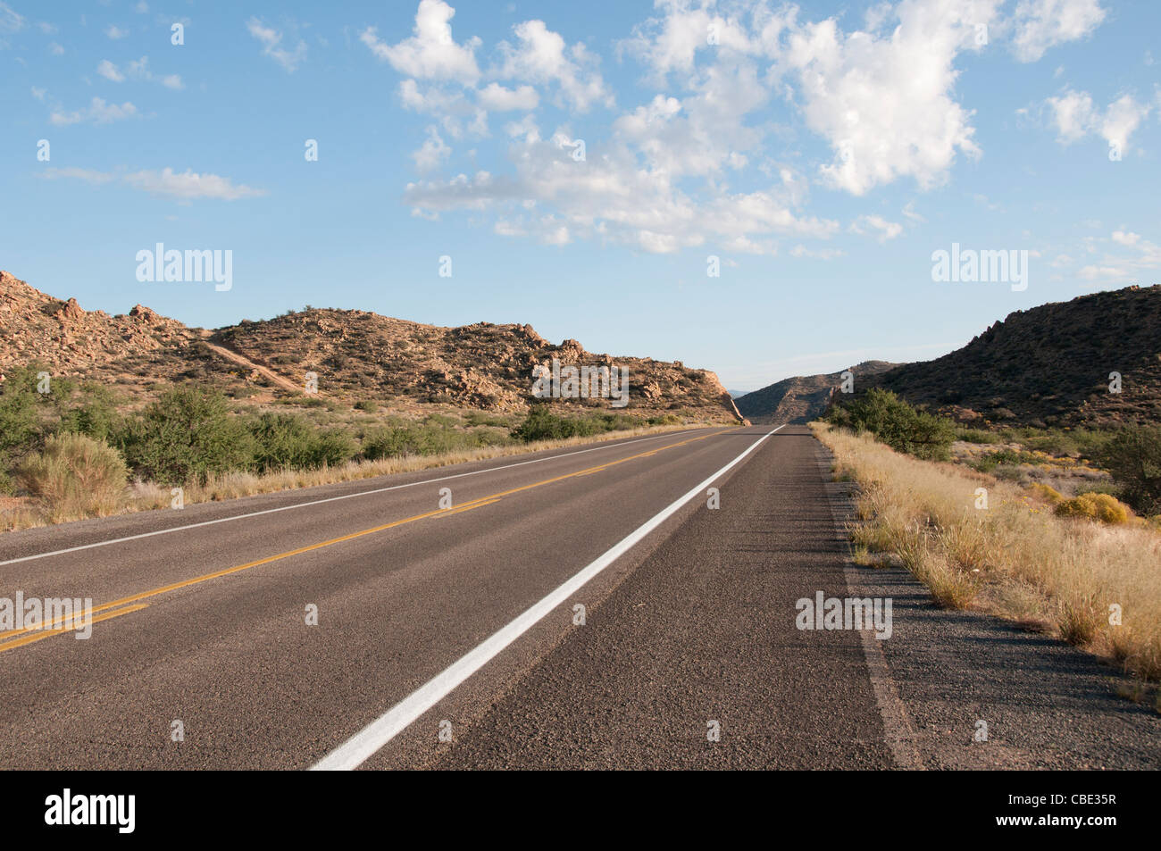 Scenic empty bending mountain road in the hills of Arizona United States - Stock Image