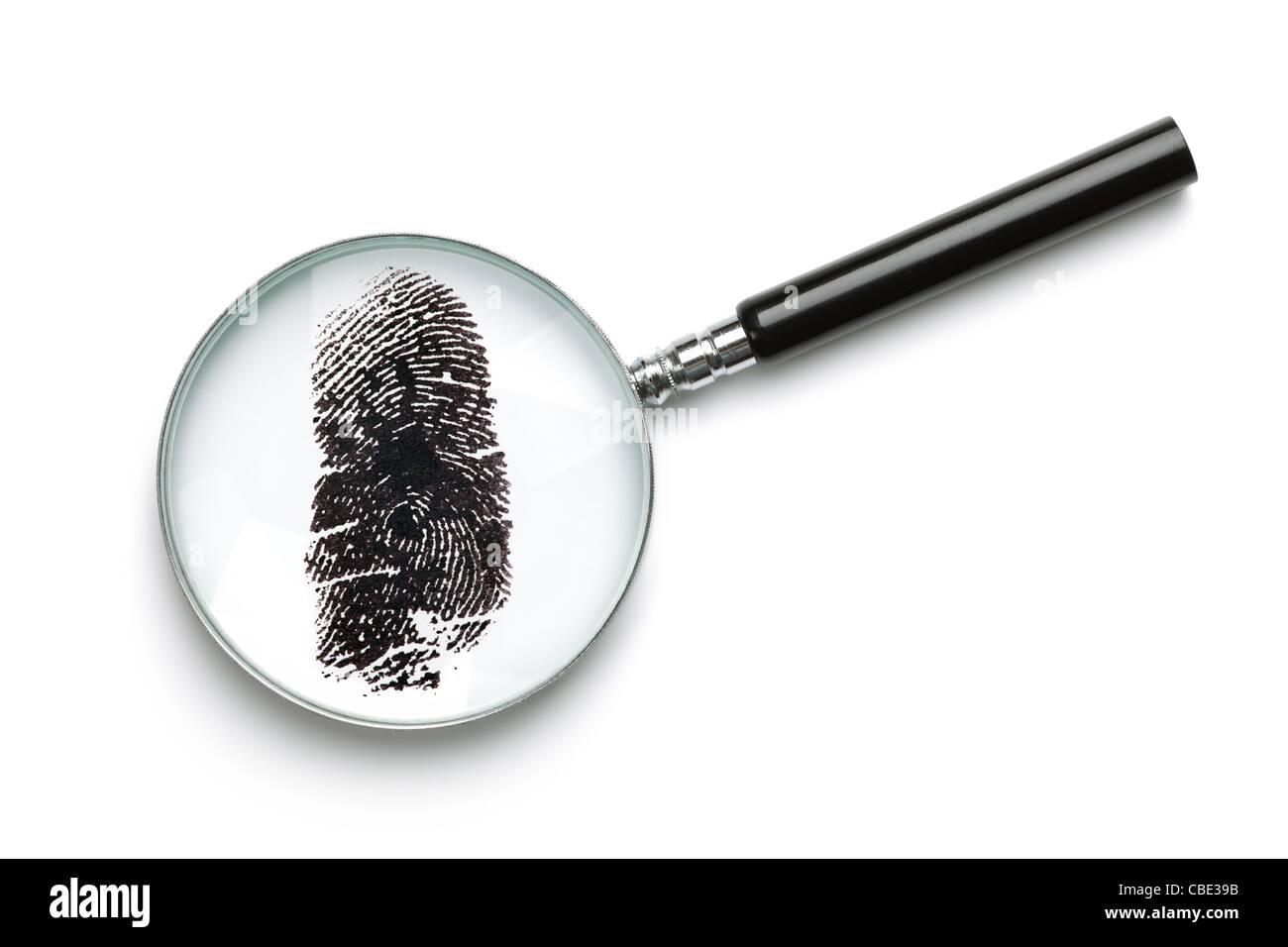 Magnifying glass examining fingerprint - Stock Image