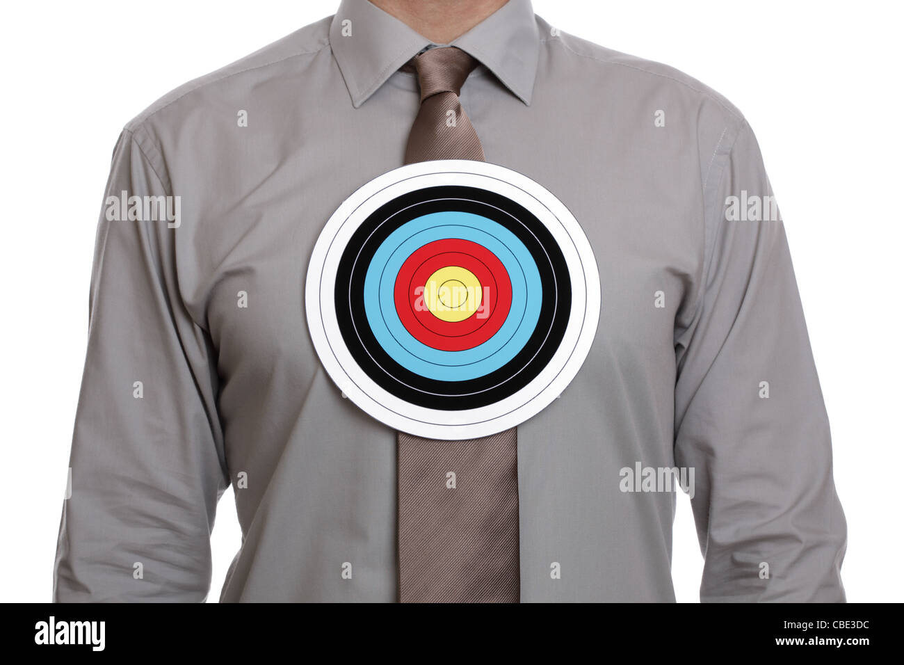 Target symbol on businessman chest - Stock Image