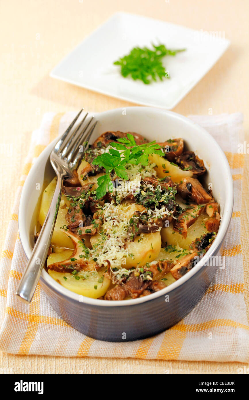 Potatoes and mushrooms. Recipe available. - Stock Image
