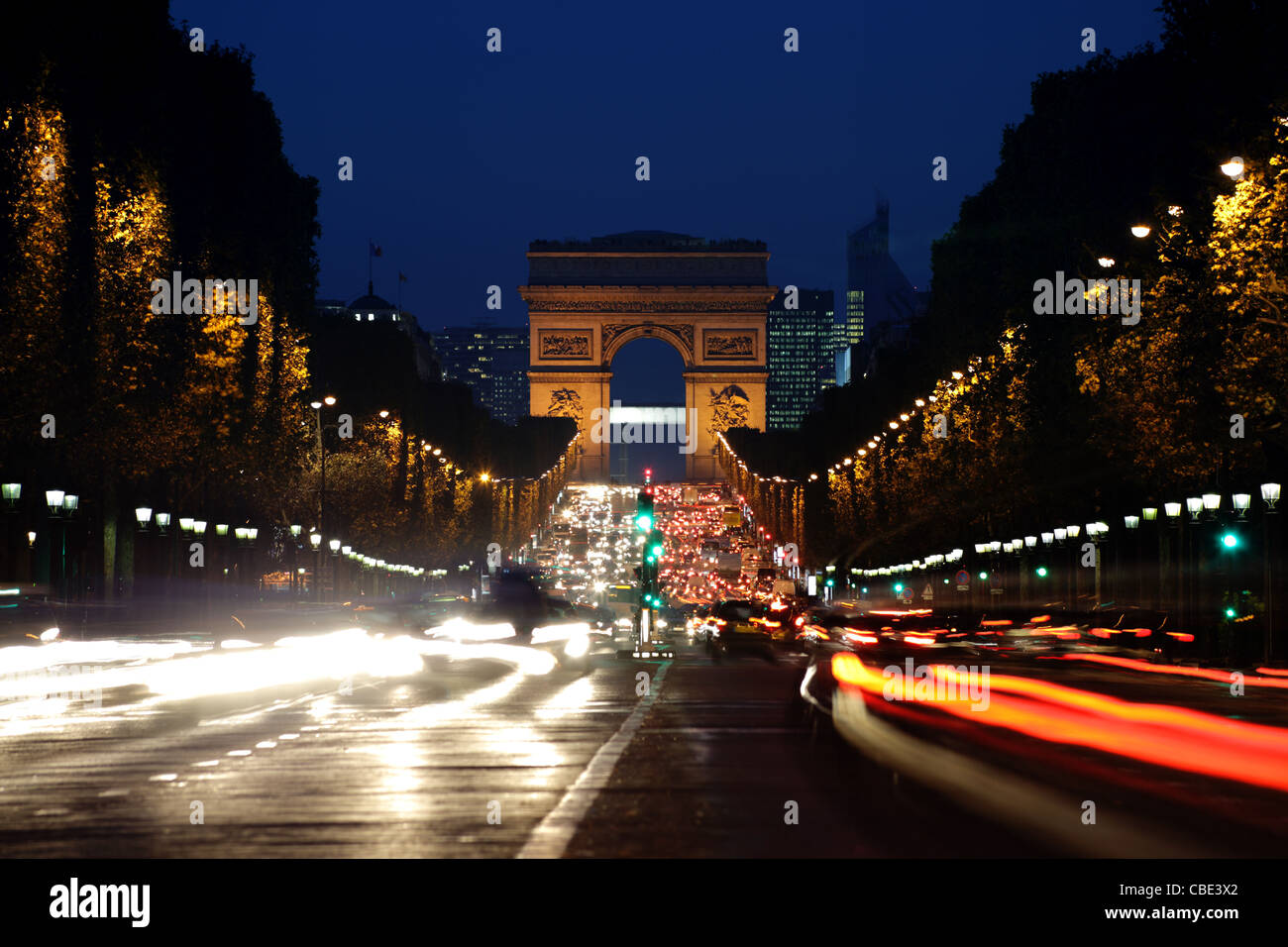 Arc de Triomphe and Champs-Elysees Avenue at night - Stock Image