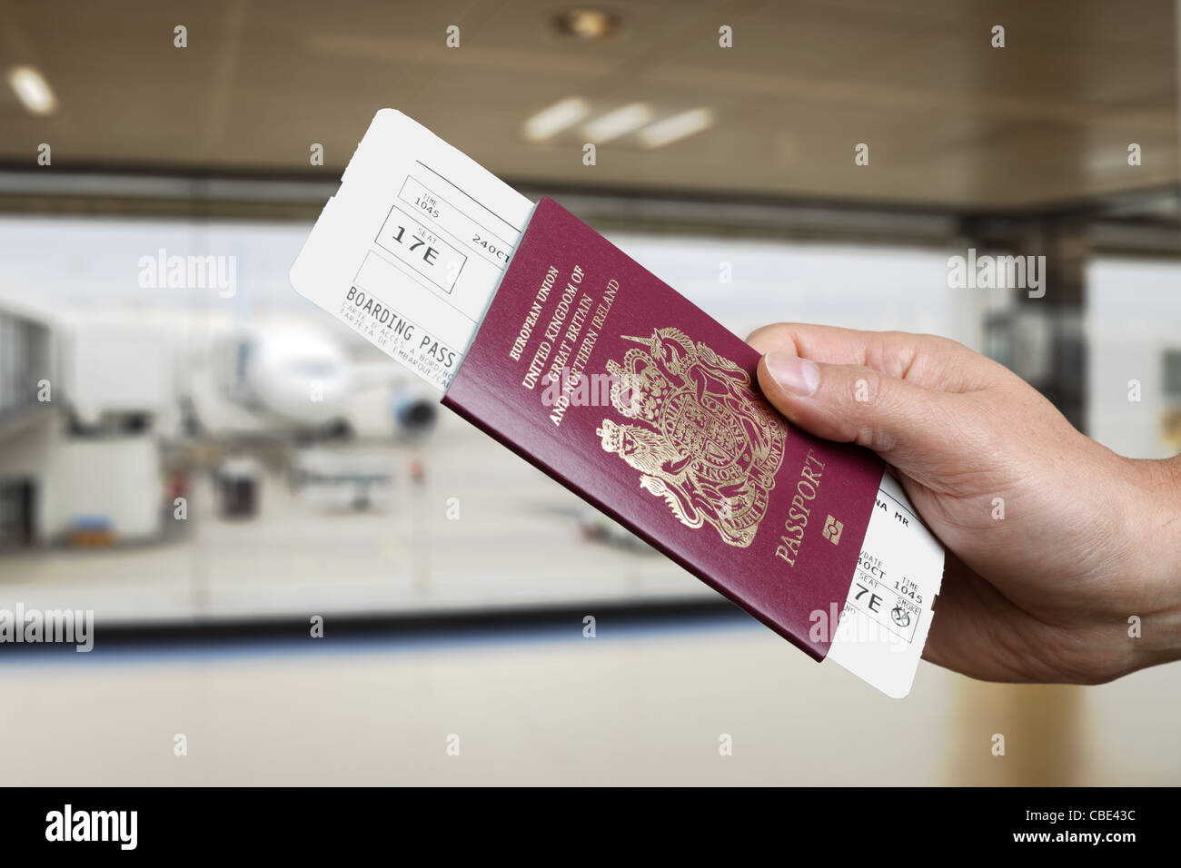 Checking in for a flight at the airport - Stock Image