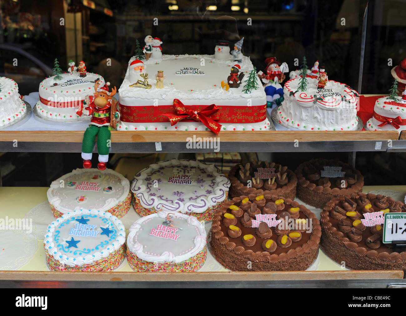 Prime Display Of Christmas And Birthday Cakes In Window Of Shop In Stock Funny Birthday Cards Online Elaedamsfinfo