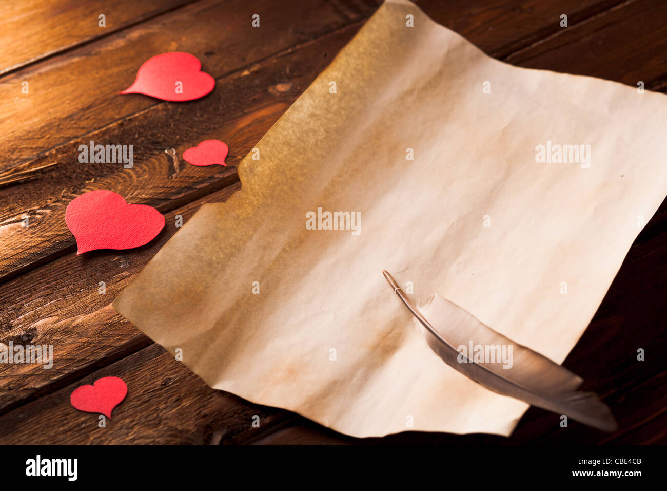 Blank Love Letter on Wood with Hearts and Feather - Stock Image