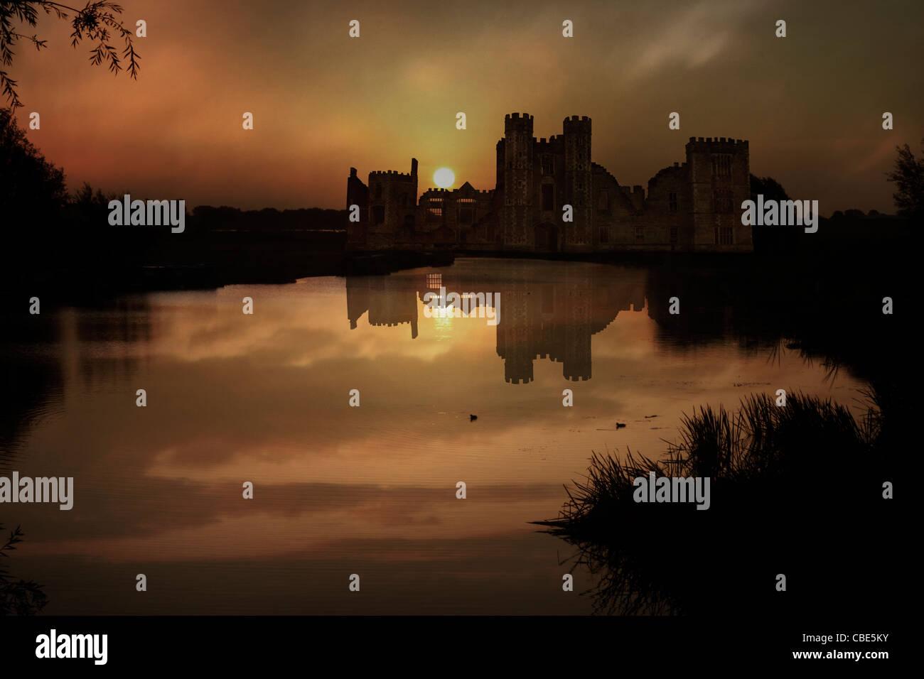 Castle Ruin On Large Lake At Sunrise - Stock Image