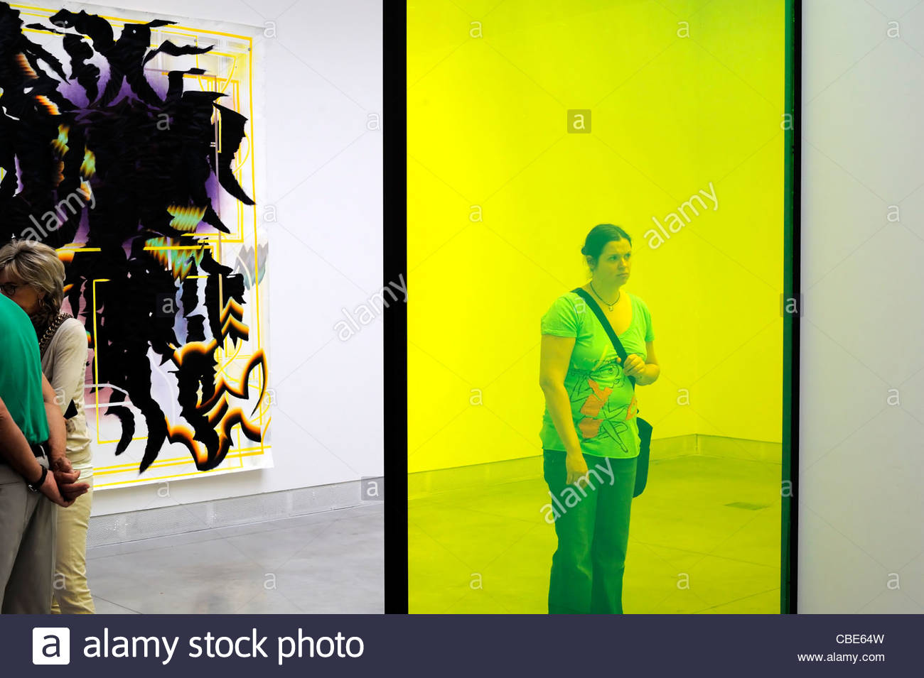 Venice Italy la Biennale female tourist looking at art object - Stock Image