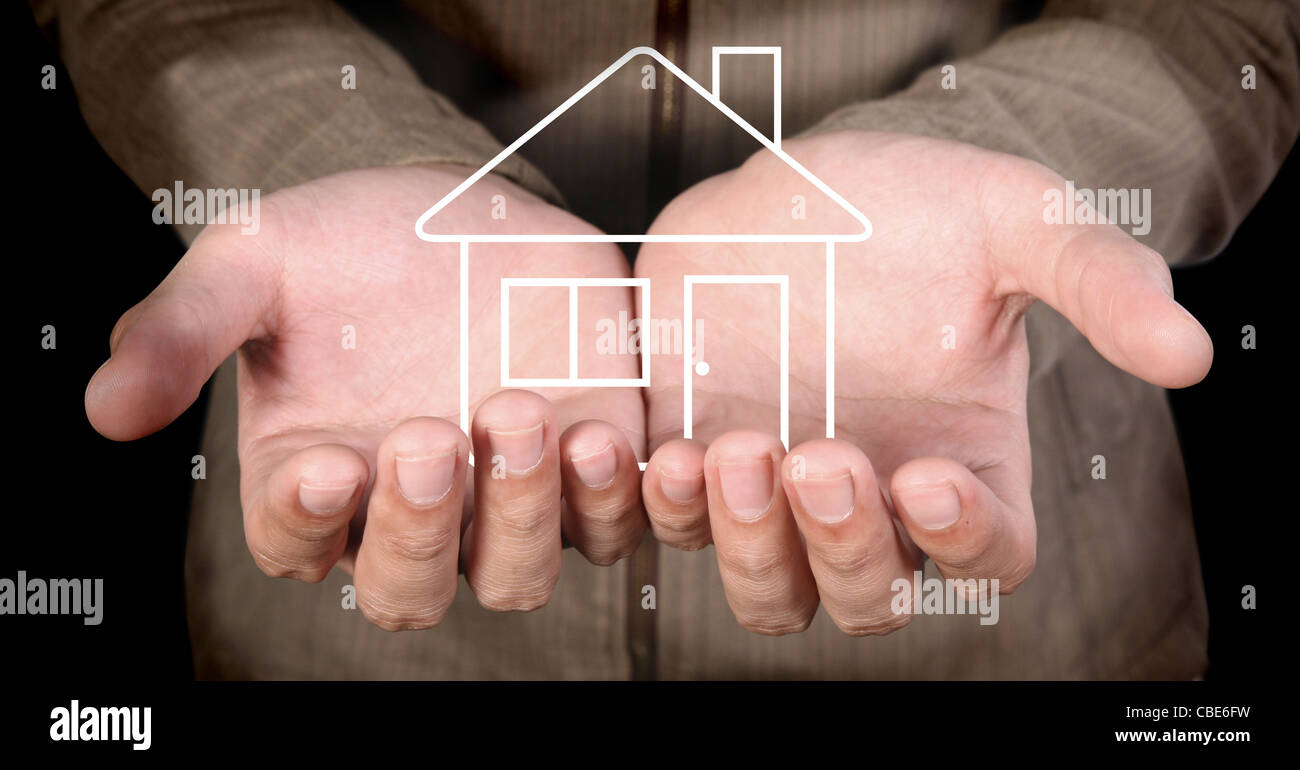 line-art house in human hands - Stock Image