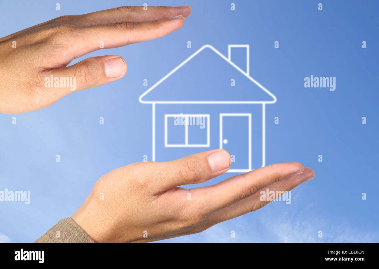 Hand house on blue sky - Stock Image