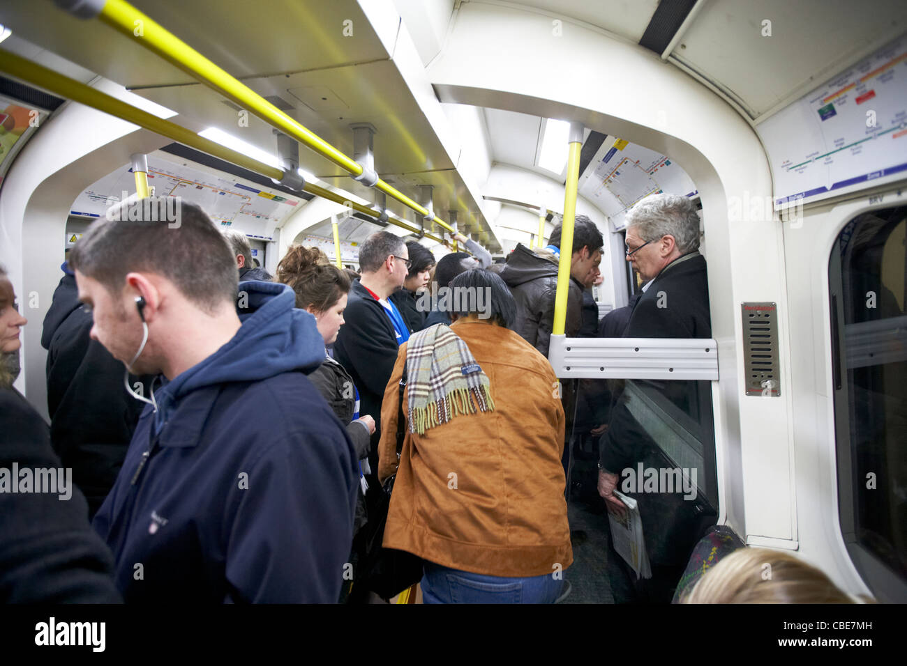 people on a crowded tube London underground England Uk United Kingdom - Stock Image