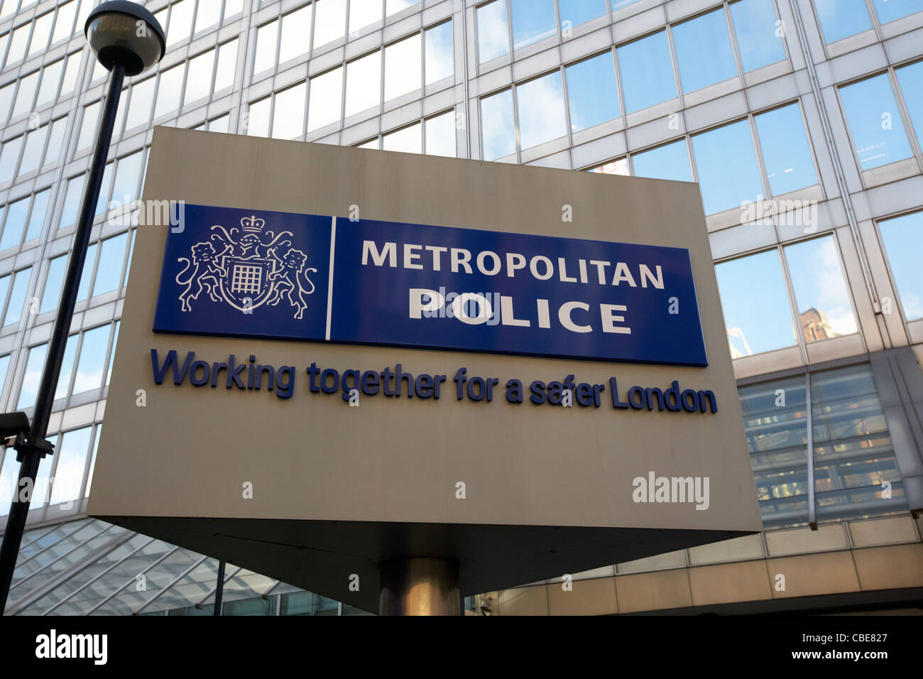 rotating sign outside the old metropolitan police headquarters New Scotland Yard broadway London England Uk United - Stock Image